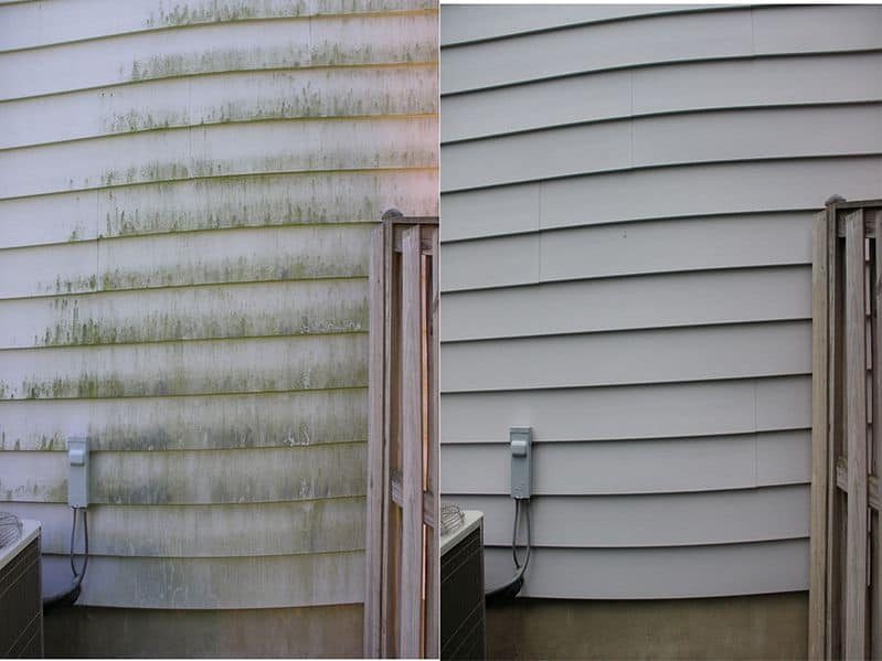 Pressure washing a house with vinyl siding